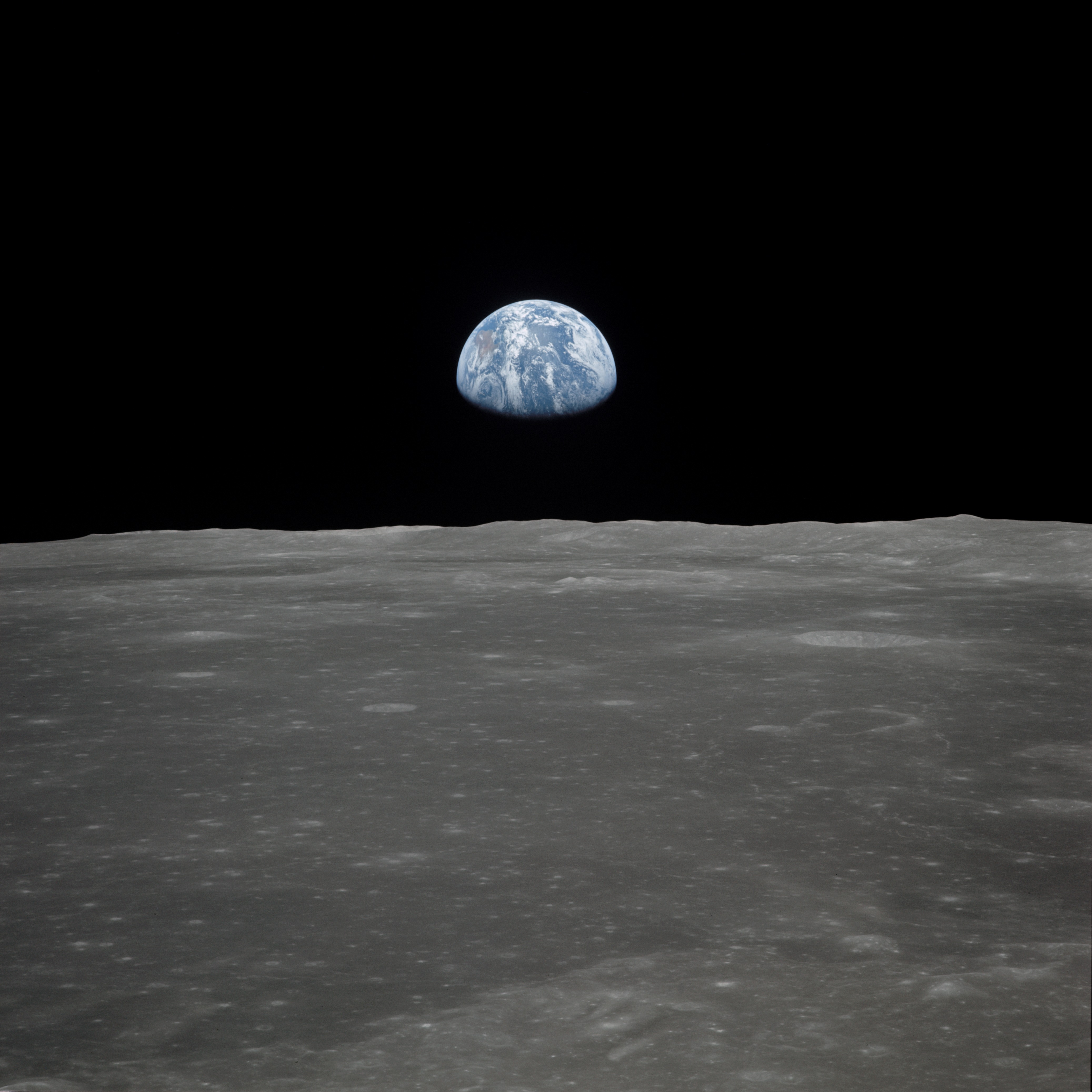 Earth Rising over the Moon's Horizon